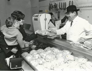 Herman Perl's serving a customer at Perl's Meats